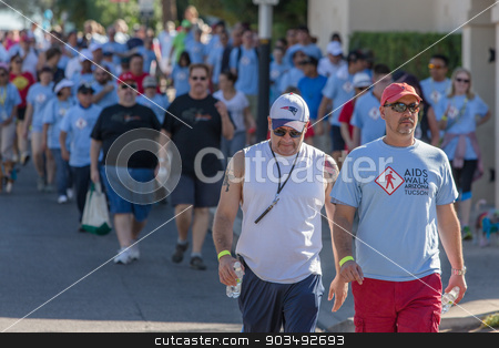 Men at AIDSwalk stock photo, TUCSON, AZ/USA - OCTOBER 12:  Walkers at AIDSwalk on October 12, 2014 in Tucson, Arizona, USA. by Scott Griessel