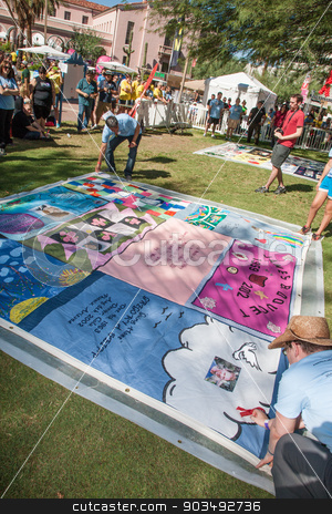 Revealing Section of AIDS Quilt at ceremony stock photo, TUCSON, AZ/USA - OCTOBER 12:  Unidentifed people at AIDS Quilt Ceremony on October 12, 2014 in Tucson, Arizona, USA. by Scott Griessel
