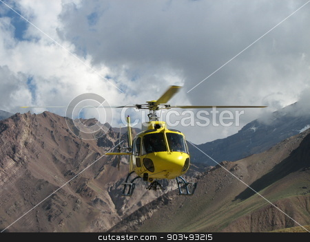 Yellow rescue helicopter in the mountains stock photo, Yellow rescue helicopter in the mountains, Argentina, South America by Alexey Kozak