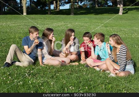 Six Teens Eating Food stock photo, Group of six happy teenagers eating healthy snacks by Scott Griessel