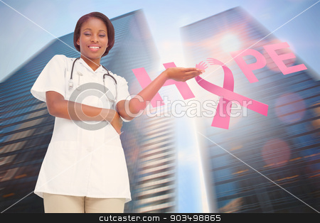 Doctor with breast cancer awareness message stock photo, Doctor with breast cancer awareness message for awareness month by Wavebreak Media