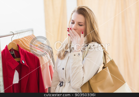 Pretty blonde woman tired during shopping stock photo, Pretty blonde woman tired during shopping in the store by Wavebreak Media