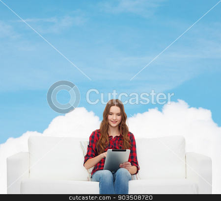 teenage girl sitting on sofa with tablet pc stock photo, home, leisure, technology and happiness concept - smiling teenage girl sitting on sofa with tablet pc comuter by Syda Productions
