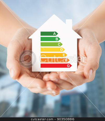 hands holding white paper house stock photo, energy saving, real estate and family home concept - closeup of female hands holding white paper house with energy efficiency rating by Syda Productions