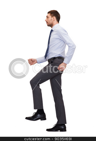 serious businessman stepping on imaginary step stock photo, business and education concept - serious businessman stepping on imaginary step by Syda Productions