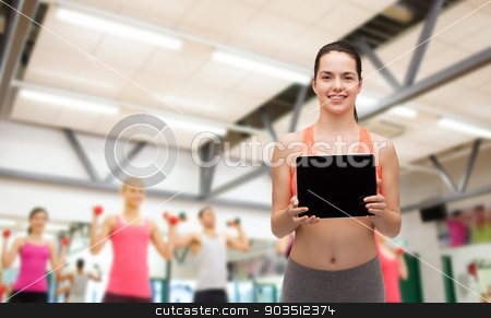 sporty woman with tablet pc blank screen stock photo, sport, exercise, technology, internet and healthcare - sporty woman with tablet pc blank screen by Syda Productions