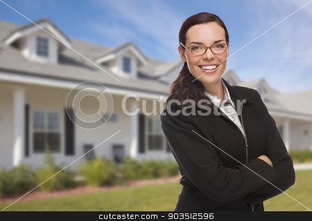 Mixed Race Woman in Front of Residential House stock photo, Attractive Mixed Race Woman in Front of Beautiful New Residential House. by Andy Dean