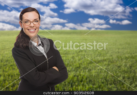 Confident Woman in Grass Field Looking At Camera stock photo, Smiling Confident Woman in Grass Field Looking At Camera. by Andy Dean