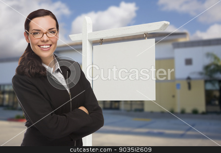 Woman In Front Commercial Building and Blank Real Estate Sign stock photo, Attractive Serious Mixed Race Woman In Front of Vacant Retail Building and Blank Real Estate Sign. by Andy Dean