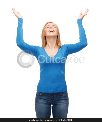 laughing young woman waving hands stock photo, happiness and people concept - laughing young woman with closed eyes waving hands by Syda Productions