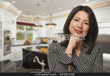 Hispanic Woman Standing in Beautiful Custom Kitchen stock photo, Attractive Hispanic Woman Standing in Beautiful Custom Kitchen. by Andy Dean