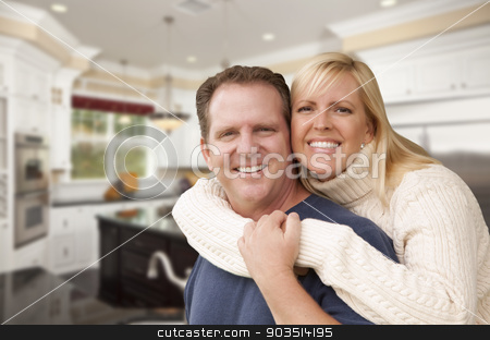 Happy Couple Inside Beautiful Custom Kitchen stock photo, Happy Couple Hugging Inside Beautiful Custom Kitchen. by Andy Dean