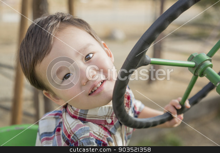 Mixed Race Young Boy Playing on Tractor stock photo, Adorable Mixed Race Young Boy Playing on the Tractor at the Pumkin Patch. by Andy Dean