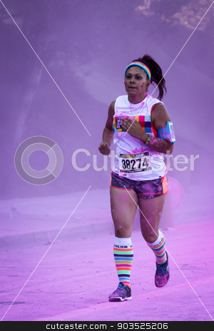 The Color Run Ventura stock photo, Ventura, CA - OCTOBER 18 :  Participants coming through the pink color station at The Color Run 2014 in Ventura. OCTOBER 18, 2014 in Ventura, CA.  by Henrik Lehnerer