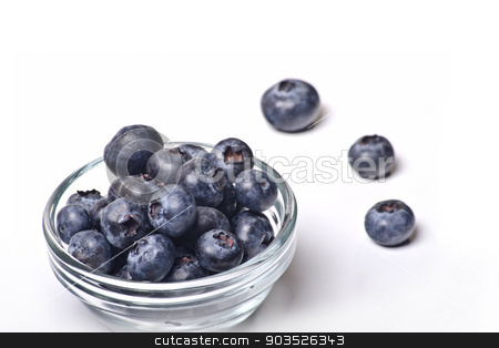 blueberries in bowl stock photo, fresh colored forest berries on white background by ursu florina