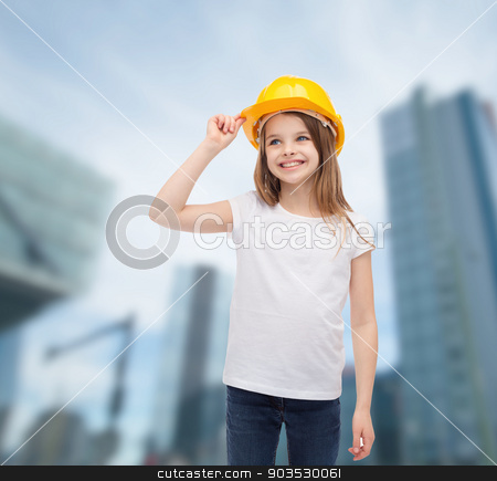 smiling little girl in protective helmet stock photo, construction and people concept - smiling little girl in protective helmet looking up by Syda Productions