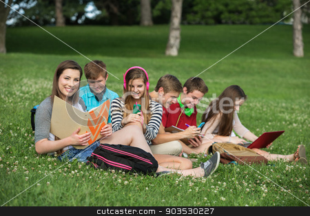 Cute Teens Studying stock photo, Happy group of male and female teens studying  by Scott Griessel