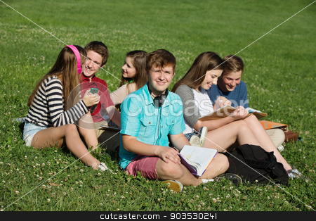 Students Doing Homework stock photo, Group of six white teenagers doing homework outdoors by Scott Griessel