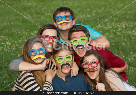 Teens in Disguise stock photo, Five teenage male and females in mustache disguise by Scott Griessel