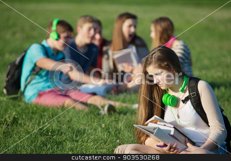 Outcast Teen Student stock photo, Sad female teenager sitting outdoors with books by Scott Griessel
