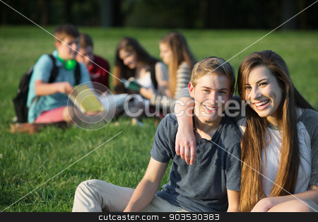 Cute Teens Embracing stock photo, Cute male and female teens outdoors embracing by Scott Griessel