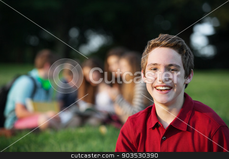 Laughing Male Teen stock photo, Laughing single male caucasian teen in red shirt by Scott Griessel