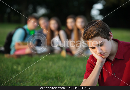 Sad Teen in Red stock photo, Sulking male caucasian teen with face in hands by Scott Griessel