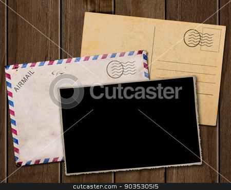 Old postcard, photo and envelope. stock photo, Old postcard, photo and envelope on wooden table. by Pablo Caridad