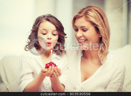 mother and daughter stock photo, picture of mother and daughter with cupcake by Syda Productions