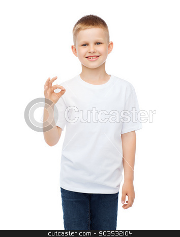 little boy in white t-shirt showing ok gesture stock photo, happy people and gesture concept - smiling little boy in blank white t-shirt showing ok gesture by Syda Productions