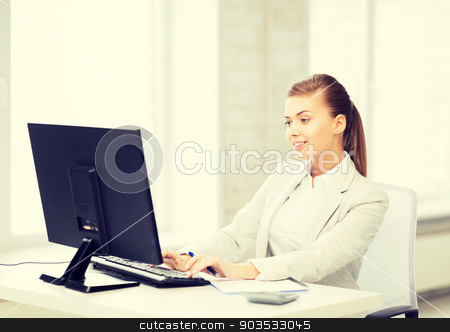 businesswoman with computer in office stock photo, picture of smiling businesswoman with computer in office by Syda Productions