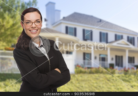 Mixed Race Woman in Front of Custom House stock photo, Attractive Mixed Race Woman in Front of Beautiful New Custom Built House. by Andy Dean