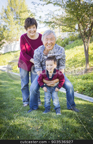 Chinese Grandparents Having Fun with Their Mixed Race Grandson O stock photo, Happy Chinese Grandparents Having Fun with Their Mixed Race Grandson Outside. by Andy Dean