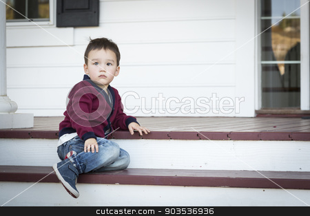 Melancholy Mixed Race Boy Sitting on Front Porch Steps stock photo, Cute Melancholy Mixed Race Boy Sitting on Front Porch Steps. by Andy Dean