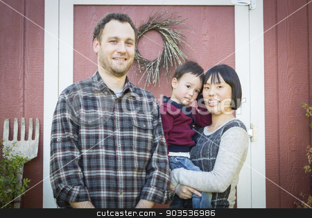 Mixed Race Family Having Fun Outside stock photo, Happy Mixed Race Family Having Fun Outside on the Grass. by Andy Dean