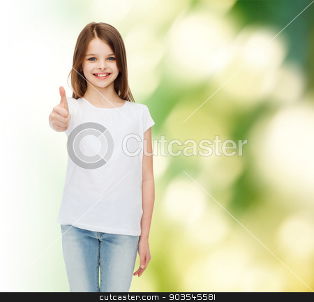 smiling little girl in white blank t-shirt stock photo, advertising, childhood, ecology and people - smiling little girl in white blank t-shirt showing thumbs up gesture over green background by Syda Productions