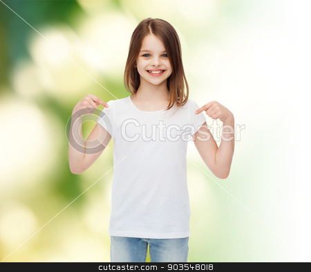 smiling little girl in white blank t-shirt stock photo, advertising, childhood, gesture, ecology and people - smiling little girl in white t-shirt pointing fingers on herself over green background by Syda Productions