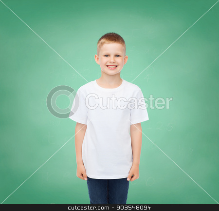 little boy in white t-shirt stock photo, happiness, childhood, school education, advertisement and people concept - smiling little boy in white t-shirt over green board background by Syda Productions