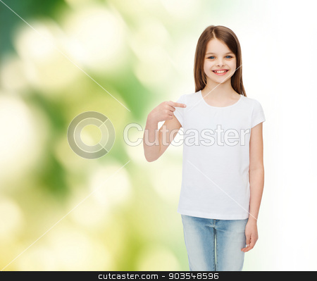 smiling little girl in white blank t-shirt stock photo, advertising, childhood, gesture, ecology and people - smiling little girl in white t-shirt pointing finger on herself over green background by Syda Productions