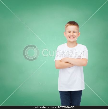 little boy in white t-shirt with arms crossed stock photo, happiness, childhood, education, school and people concept - smiling little boy in white t-shirt over green board background by Syda Productions