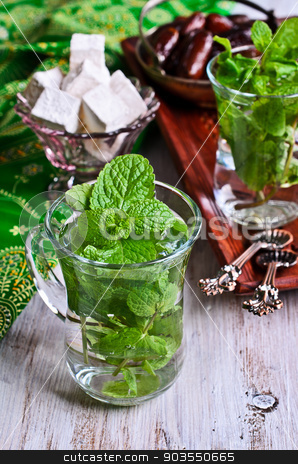 Tea with mint stock photo, Traditional Oriental tea with mint leaves in a glass  by zia_shusha