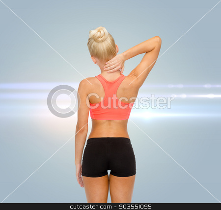 sporty woman touching her neck stock photo, fitness, healthcare and medicine concept - sporty woman touching her neck by Syda Productions