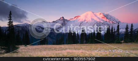 Smokey Sunrise Mt Rainier National Park Cascade Volcanic Arc stock photo, The morning sun just starting to hit the tip of Mount Rainier by Christopher Boswell