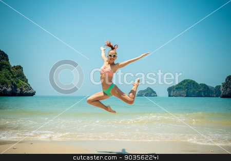 Fun girl jumping  stock photo, Fun girl wearing bikini jumping on a beach by Nikita Buida