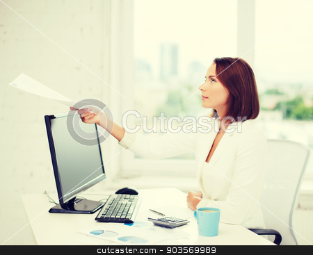 businesswoman giving papers in office stock photo, business concept - businesswoman giving papers to somebody in office by Syda Productions