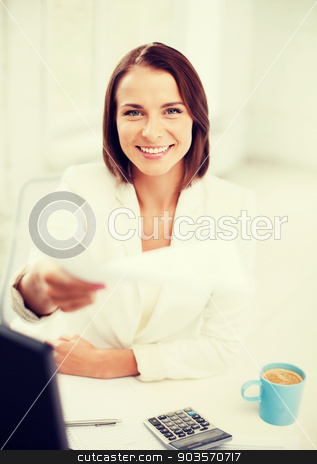 businesswoman giving papers in office stock photo, business concept - businesswoman giving papers in office by Syda Productions