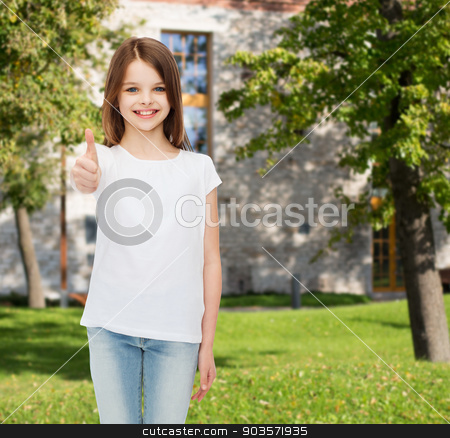 smiling little girl in white blank t-shirt stock photo, advertising, summer vacation, gesture, childhood and people - smiling little girl in white t-shirt showing thumbs up over campus background by Syda Productions
