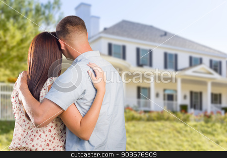 Military Couple Looking at Nice New House stock photo, Affectionate Military Couple Looking at Nice New House. by Andy Dean