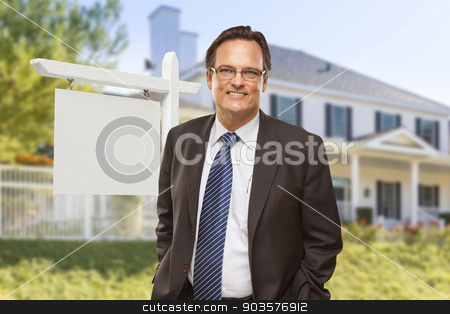 Male Real Estate Agent in Front of Blank Sign and House stock photo, Male Real Estate Agent in Front of Blank Home For Sale Sign and House. by Andy Dean