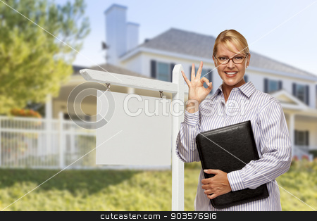 Real Estate Agent in Front of Blank Sign and House stock photo, Attractive Female Real Estate Agent in Front of Blank Real Estate Sign and House. by Andy Dean